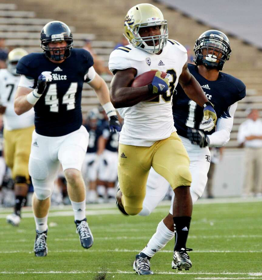 UCLA running back Johnathan Franklin (23) rushes for a touchdown past Rice linebacker Kle Prater (44) and safety Michael Hill (11) during the first half of an NCAA college football game, Thursday, Aug. 30, 2012, in Houston. (AP Photo/Eric Kayne) Photo: Eric Kayne / FR170049 AP