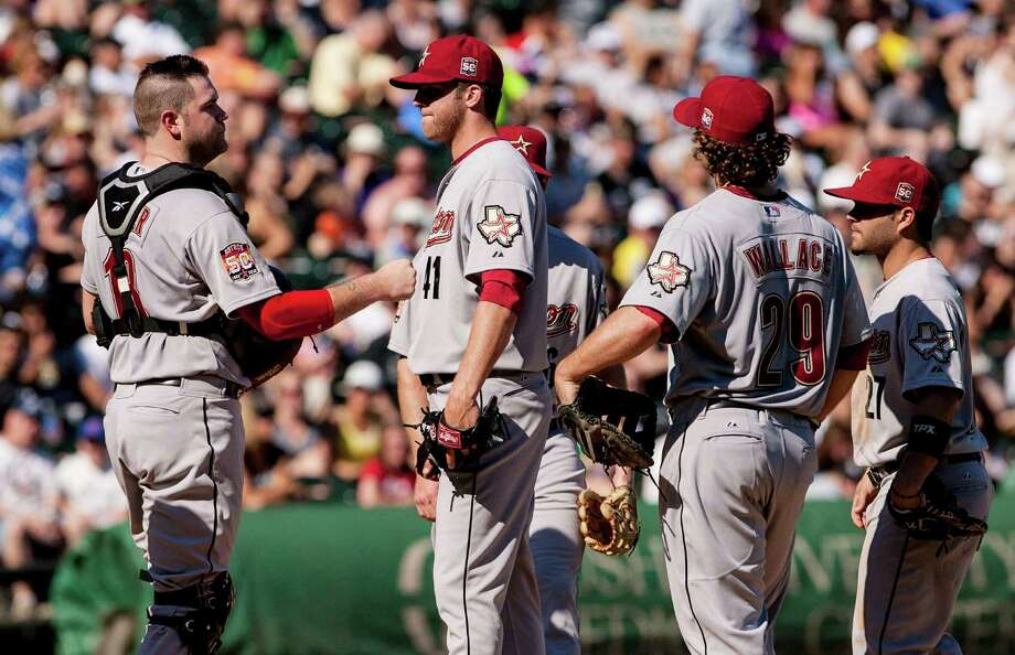 June 9: White Sox 10, Astros 1Jordan Lyles, center, gets a fist bump to his chest by catcher Chris Snyder, center left, as he is about to be taken out of the game after giving up five runs in the fifth inning.Record: 25-34. Photo: Charles Cherney