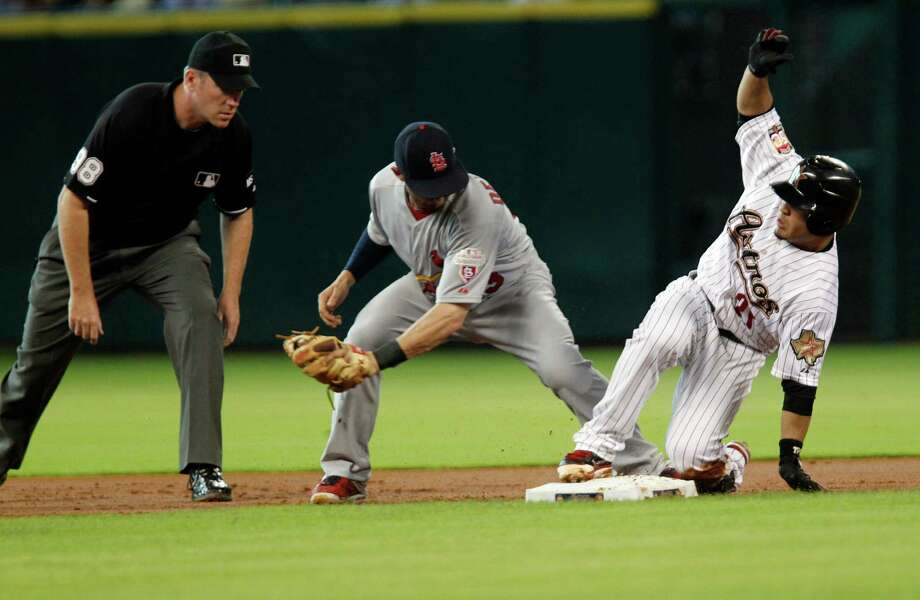 June 5: Astros 9, Cardinals 8Astros left fielder J.D. Martinez left slides past the Cardinals catcher Tony Cruz to steal home plate to score a run on a wild pitch.Record: 24-31. Photo: James Nielsen, Chronicle / © Houston Chronicle 2012