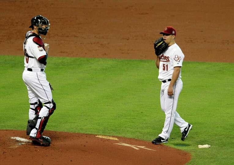 June 2: Reds 12, Astros 9 Astros catcher Jason Castro, left, walks to the pi