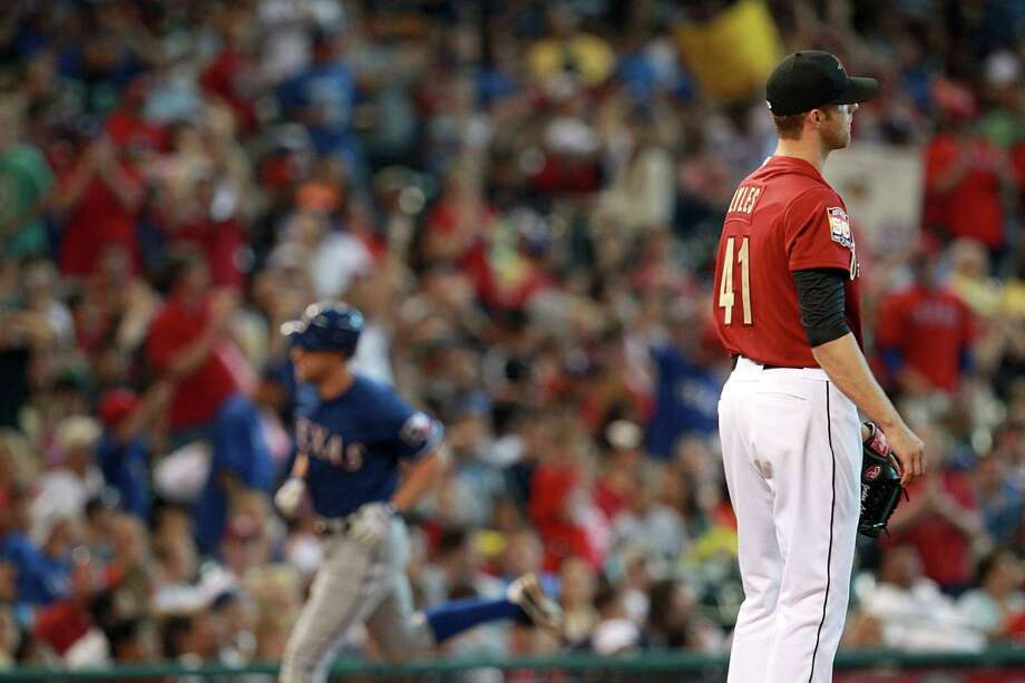May 20: Rangers 6, Astros 1 Jordan Lyles looks on as David Murphy rounds third base after he hit a home run in the fifth inning.Record: 18-23. Photo: Johnny Hanson / © 2012  Houston Chronicle