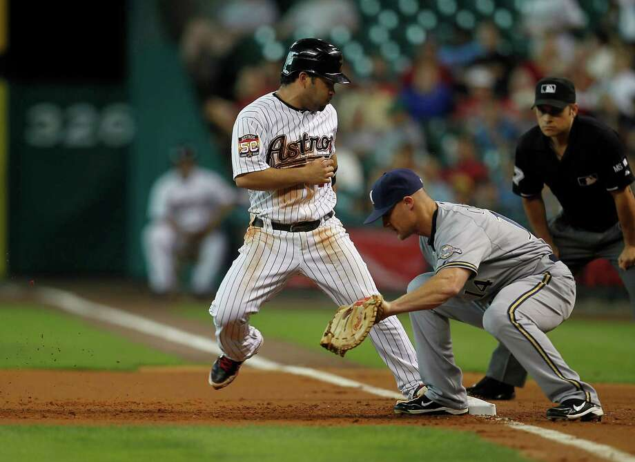 May 17: Astros 4, Brewers 0 Astros second baseman Jose Altuve (27) jumps back to first base as Milwaukee Brewers second baseman Brooks Conrad (14) covers the base.Record: 17-21. Photo: Karen Warren, Houston Chronicle / © 2012  Houston Chronicle