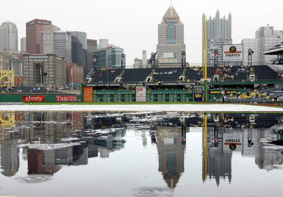 May 13: Pirates 3, Astros 2 (12 innings) Raindrops spatter the reflection of the Pittsburgh skyline reflected in water pooled atop a dugout at PNC Park before the Astros' Mother's Day game against the Pirates. The Astros blew a 2-1 lead in the ninth before losing in extra innings.Record: 15-19. Photo: Keith Srakocic, Associated Press / AP