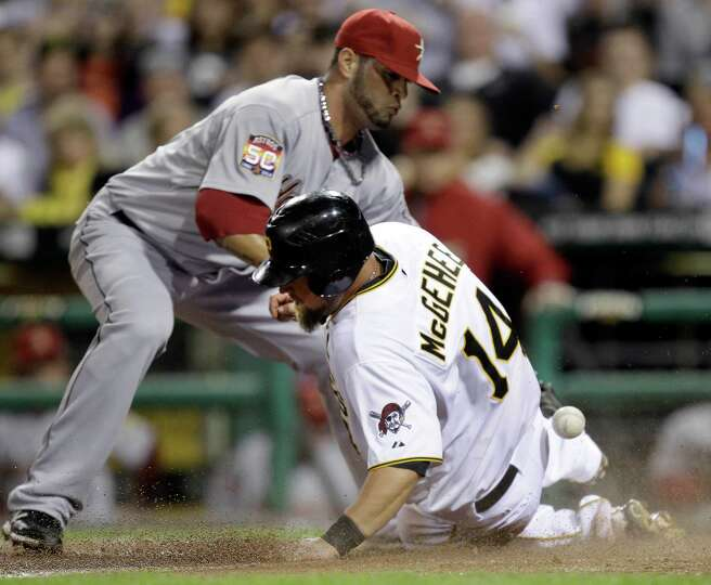 May 12: Pirates 5, Astros 2 Pittsburgh's Casey McGhee (14) slides safely hom