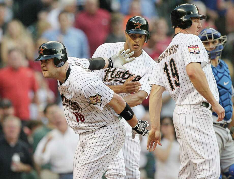 May 1: Astros 6, Mets 3 Chris Snyder is congratulated by Brian Bogusevic (19) and Justin Maxwell (22) after hitting a three-run home run.Record: 10-14. Photo: Bob Levey, Getty Images / 2012 Getty Images