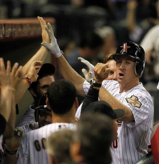 April 30: Astros 4, Mets 3 Second baseman Matt Downs celebrates with  teamma