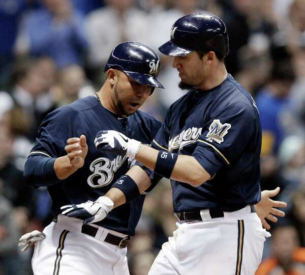 April 24: Brewers 9, Astros 6 Brewers' Travis Ishikawa, right, is congratula