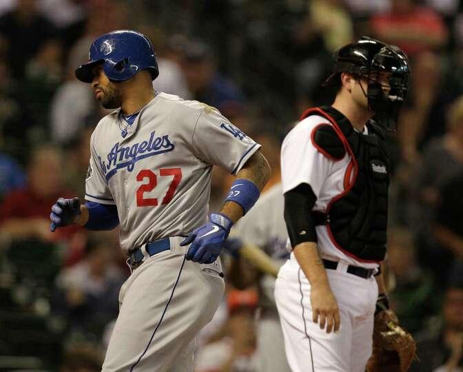 April 20: Dodgers 3, Astros 1 Los Angeles' Matt Kemp crosses the plate past