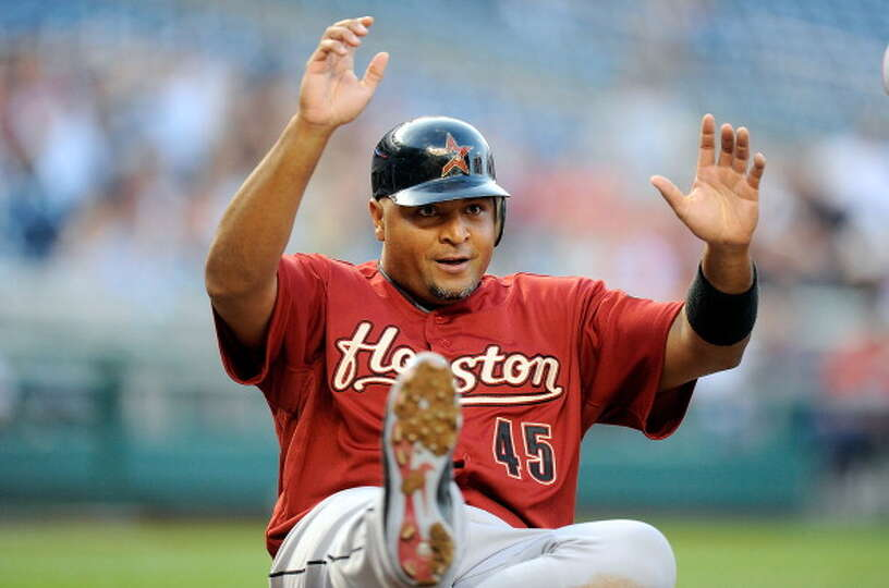 April 19: Astros 11, Nationals 4 Carlos Lee of the Astros scores in the firs