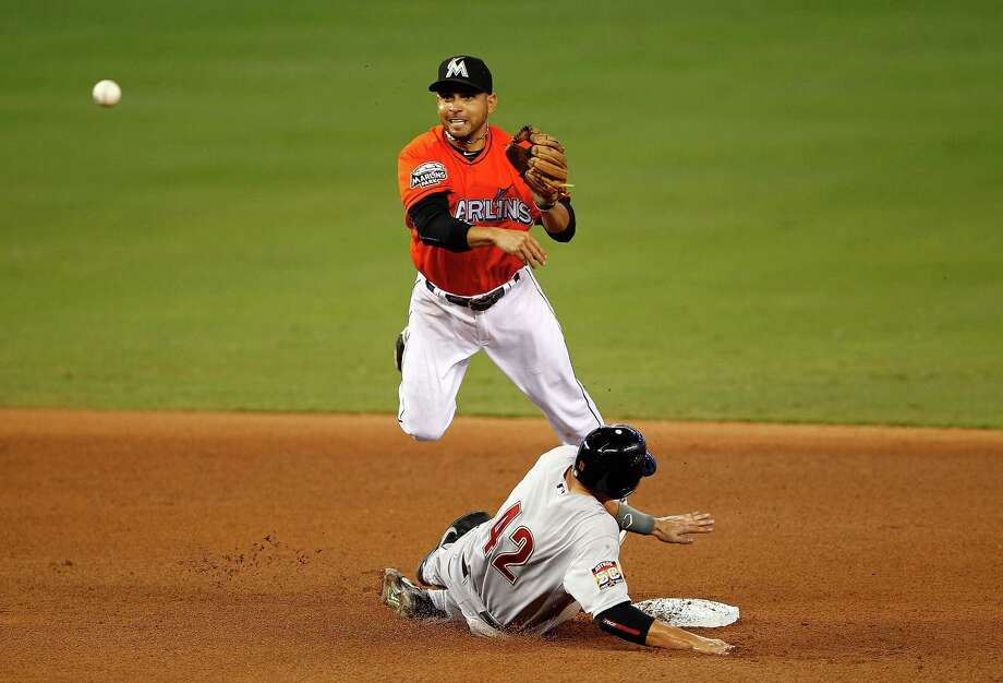 April 15: Marlins 5, Astros 4 (11 innings) Marlins second baseman Omar Infante throws to first as Astros catcher Jason Castro slides into second. Both teams wore the number 42 in honor of Jackie Robinson Day.Record: 4-5. Photo: Mike Ehrmann, Getty Images / 2012 Getty Images