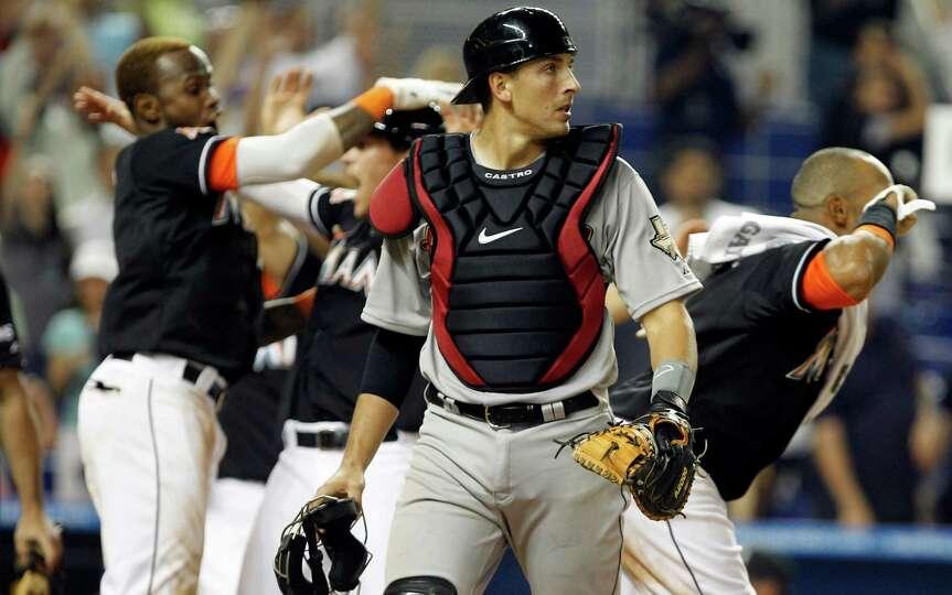 April 13: Marlins 5, Astros 4 (11 innings) Astros catcher Jason Castro, cent
