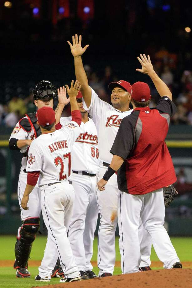 April 7: Astros 7, Rockies 3 The Astros celebrate after beating Colorado at Minute Maid to earn their first victory of the season. Lucas Harrell tossed seven shutout innings to earn the win.Record: 1-1. Photo: Smiley N. Pool, Houston Chronicle / © 2012  Houston Chronicle