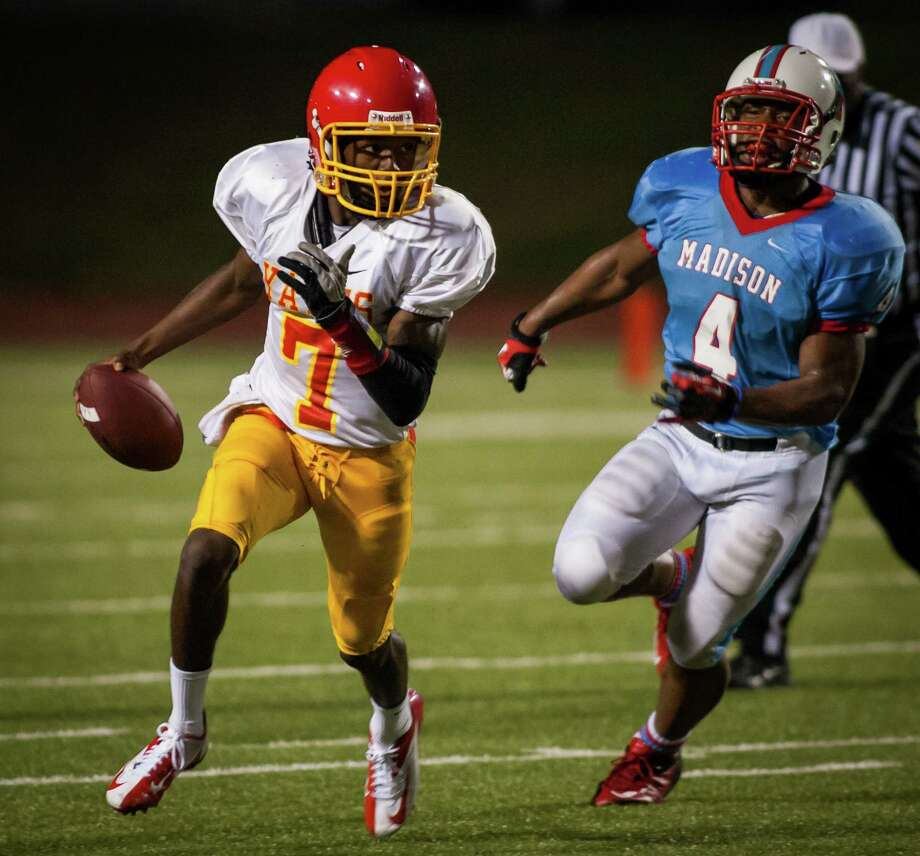 Yates quarterback Joshua Simmons runs with the ball during the fourth quarter of a high school football game at Barnett Stadium on Friday, Sept. 14, 2012, in Houston. Madison defeated Yates 35-0. Photo: Andrew Richardson, For The Chronicle / © 2012 Andrew Richardson