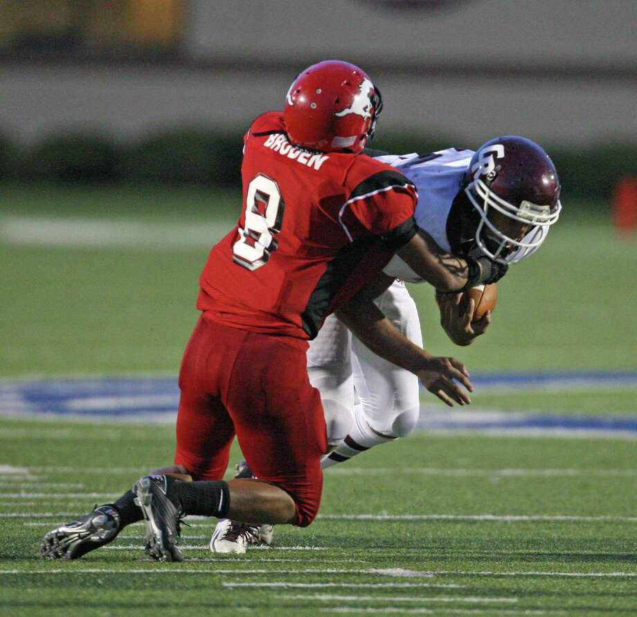 Cinco Ranch's Jonathan Lugo (45) is tackled for a loss by North Shore's Tim Broden during the first half of a high school football game, Friday, September 14, 2012 at Galena Park I.S.D. Stadium in Houston, TX. Photo: Eric Christian Smith, For The Chronicle