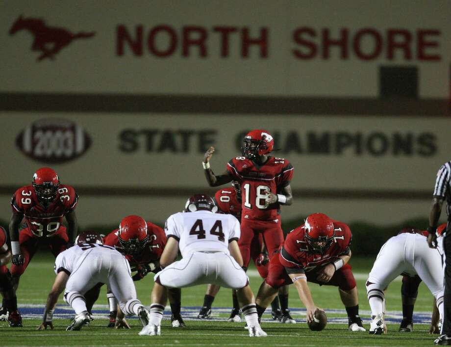 North Shore quarterback Micah Thomas directs a teammate at the line of scrimmage during the first half of a high school football game against Cinco Ranch, Friday, September 14, 2012 at Galena Park I.S.D. Stadium in Houston, TX. Photo: Eric Christian Smith, For The Chronicle