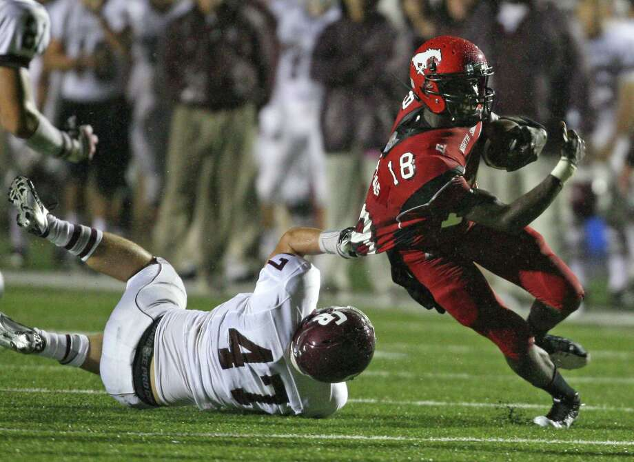 North Shore's Micah Thomas (18) is tackled by Cinco Ranch's Justin Felske during the first half of a high school football game, Friday, September 14, 2012 at Galena Park I.S.D. Stadium in Houston, TX. Photo: Eric Christian Smith, For The Chronicle