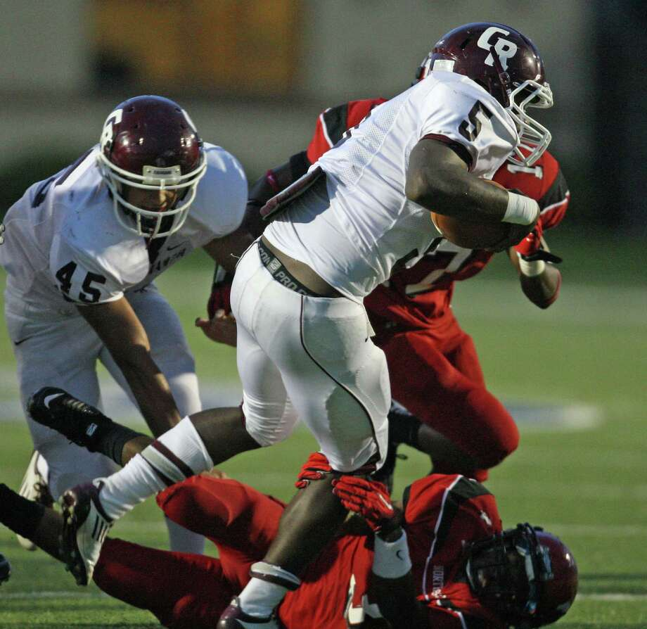 Cinco Ranch's Denzell Bates (5) is tackled by North Shore's Chris Russell (3) during the first half of a high school football game, Friday, September 14, 2012 at Galena Park I.S.D. Stadium in Houston, TX. Photo: Eric Christian Smith, For The Chronicle