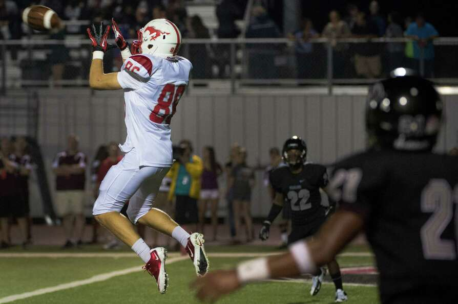 Memorial wide receiver Morgan Whatley catches a touchdown pass during the second half of a high scho