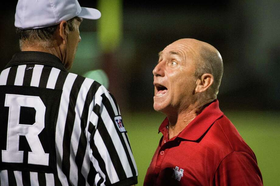 Memorial head coach Gary Koch argues with the referee during the second half of a high school football game against Pearland at The Rig on Friday, Sept. 14, 2012, in Pearland. Photo: Smiley N. Pool, Houston Chronicle / © 2012  Houston Chronicle