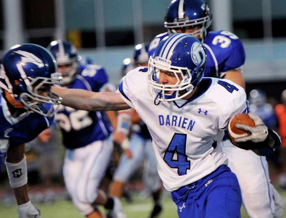Darien high school's Jackson Whiting breaking through the Fairfield Ludlowe high school defense during the first football game of the 2012 season held at Fairfield Ludlowe high school, Fairfield, CT on Friday September 14th 2012 Photo: Mark Conrad / Connecticut Post Freelance