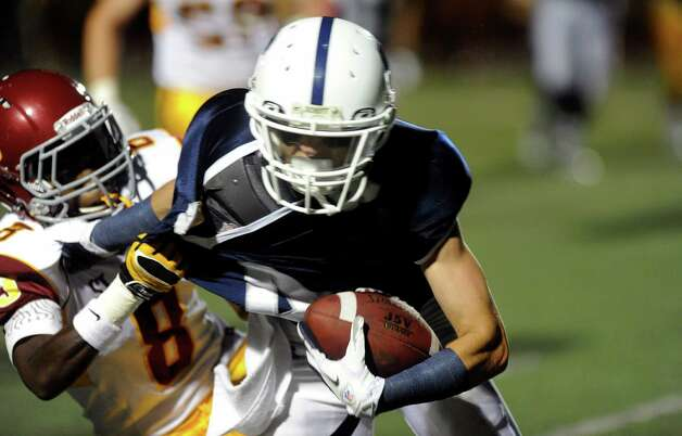 Staples' James Frusciante carries the ball during Friday's game against St. Joseph at Staples High School in Westport on September 14, 2012. Photo: Lindsay Niegelberg / Stamford Advocate
