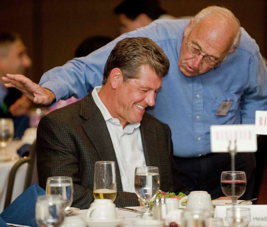 UConn women's basketball coach Geno Auriemma has a visit with George Barto of New Fairfield at the Amber Room Colonnade in Danbury, where Coach Auriemma spoke at the UCONN Alumni Association dinner. Monday, Sept. 10, 2012 Photo: Scott Mullin / The News-Times Freelance