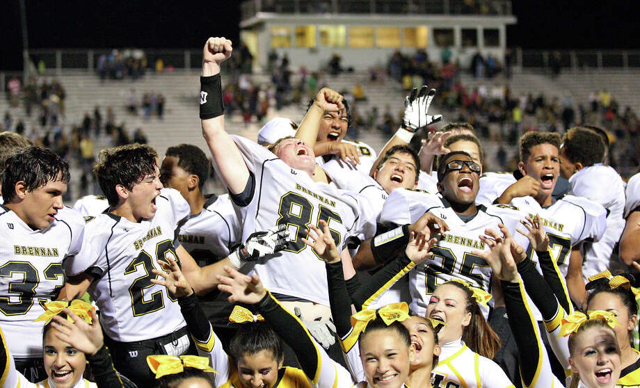 Members of the Brennan Bears football team celebrate their 24-0 win over East Central Friday Sept. 14, 2012 at Hornet Stadium. Photo: Edward A. Ornelas, Express-News / © 2012 San Antonio Express-News