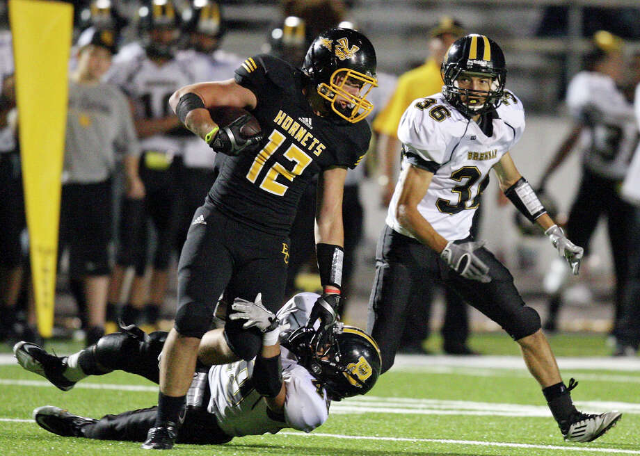 East Central's Brett Casey tries to shake the tackle of Brennan's Michael Huron as Brennan's Joel Silva moves in on the play during second half action Friday Sept. 14, 2012 at Hornet Stadium. Brennan won 24-0. Photo: Edward A. Ornelas, Express-News / © 2012 San Antonio Express-News