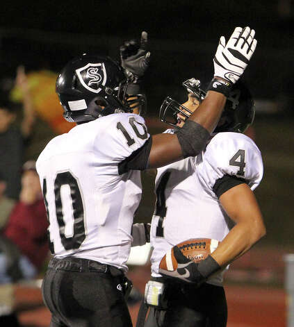 Steele's Justin Stockton (04) gestures after running for a 51-yard touchdown as teammate L.G. Williams (10) goes to congratulate during their game against Tivy in Kerrville on Friday, Sept. 14, 2012. Photo: Kin Man Hui, Express-News / ©2012 San Antonio Express-News