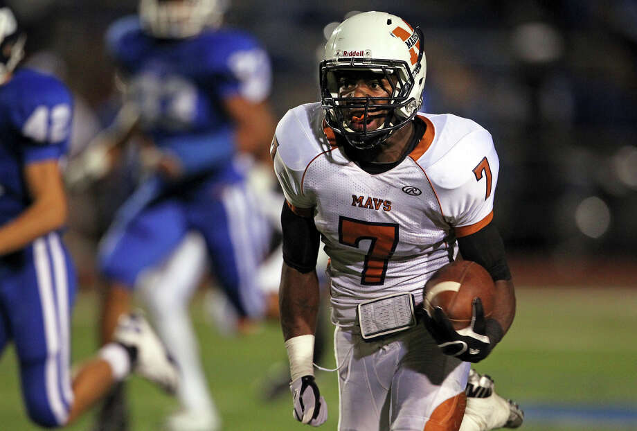 Madison running back Marquis Warford burns the Unicorns for a long touchdown run in the second quarter as Madison plays New Braunfels at New Braunfels Stadium on September 14, 2012. Photo: Tom Reel, Express-News / ©2012 San Antono Express-News