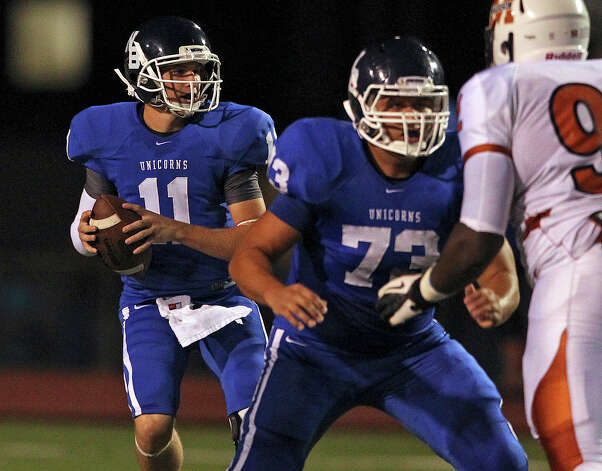 Unicorn quarterback Weston King looks for a target as Madison plays New Braunfels at New Braunfels Stadium on September 14, 2012. Photo: Tom Reel, Express-News / ©2012 San Antono Express-News