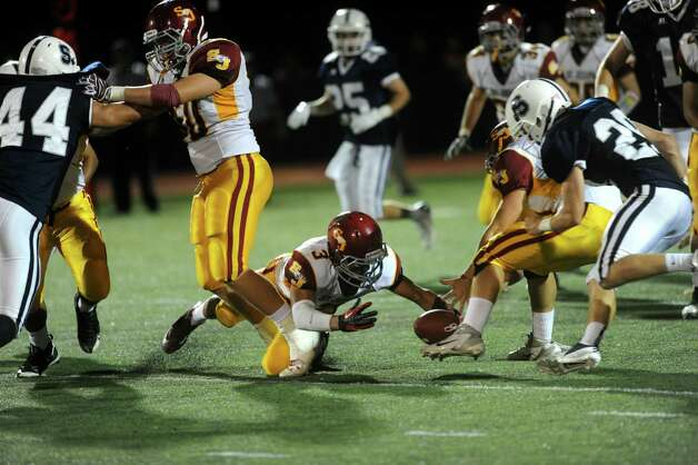 St. Joseph's Jake Pelletier dives for a fumble during Friday's game at Staples High School in Westport on September 14, 2012. Photo: Lindsay Niegelberg / Stamford Advocate