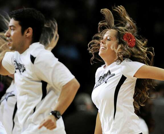 The San Antonio Silver Stars' Star Squad performs during the first half of a WNBA basketball game against the Seattle Storm, Friday Sept. 14, 2012, in San Antonio. San Antonio won 90-66. Photo: Darren Abate, Express-News
