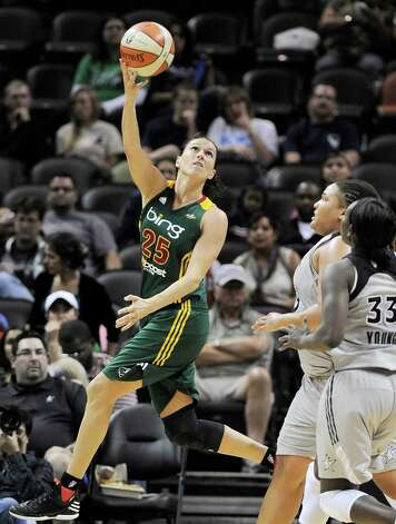 Seattle Storm's Svetlana Abrosimova (25) shoots over San Antonio Silver Stars' Sophia Young (33) and Danielle Adams during the second half of a WNBA basketball game, Friday Sept. 14, 2012, in San Antonio. San Antonio won 90-66. Photo: Darren Abate, Express-News