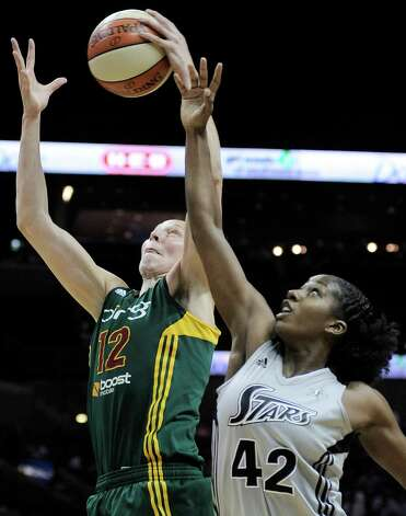Ann Wauters (12), of Belgium, shoots over San Antonio Silver Stars' Shenise Johnson during the second half of a WNBA basketball game, Friday Sept. 14, 2012, in San Antonio. San Antonio won 90-66. Photo: Darren Abate, Express-News