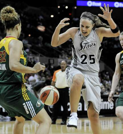 San Antonio Silver Stars' Becky Hammon (25), loses the ball as she approaches Seattle Storm's Alysha Clark during the second half of a WNBA basketball game, Friday Sept. 14, 2012, in San Antonio. San Antonio won 90-66. Photo: Darren Abate, Express-News