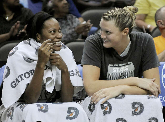 San Antonio Silver Stars' Jayne Appel, right, and Jia Perkins laugh on the bench during the second half of a WNBA basketball game, Friday Sept. 14, 2012, in San Antonio. San Antonio won 90-66. Photo: Darren Abate, Express-News