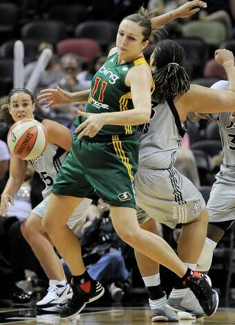 Seattle Storm's Ewelina Kobryn (11), of Poland, collides with San Antonio Silver Stars' Danielle Adams during the second half of a WNBA basketball game, Friday Sept. 14, 2012, in San Antonio. San Antonio won 90-66. Photo: Darren Abate, Express-News