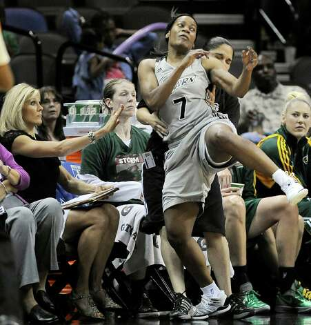 San Antonio Silver Stars' Jia Perkins (7) falls into the Seattle Storm bench during the second half of a WNBA basketball game, Friday Sept. 14, 2012, in San Antonio. San Antonio won 90-66. Photo: Darren Abate, Express-News