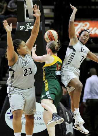 Seattle Storm's Katie Smith, center, collides with San Antonio Silver Stars' Danielle Adams, left, and Jia Perkins during the second half of a WNBA basketball game, Friday Sept. 14, 2012, in San Antonio. San Antonio won 90-66. Photo: Darren Abate, Express-News