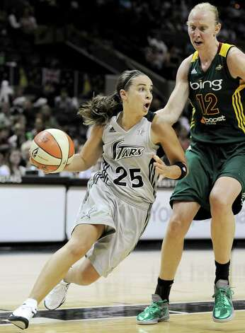 San Antonio Silver Stars' Becky Hammon (25) drives around Seattle Storm's Ann Wauters, of Belgium, during the second half of a WNBA basketball game, Friday Sept. 14, 2012, in San Antonio. San Antonio won 90-66. Photo: Darren Abate, Express-News