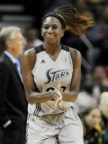 San Antonio Silver Stars' Shameka Christon celebrates a three-point basket during the first half of a WNBA basketball game against the Seattle Storm, Friday Sept. 14, 2012, in San Antonio. Photo: Darren Abate, Express-News