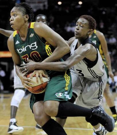 San Antonio Silver Stars' Danielle Robinson, right, defends against Seattle Storm's Tanisha Wright during the first half of a WNBA basketball game, Friday Sept. 14, 2012, in San Antonio. Photo: Darren Abate, Express-News