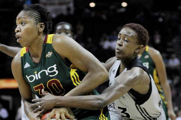 San Antonio Silver Stars' Danielle Robinson, right, defends against Seattle Storm's Tanisha Wright during the first half of a WNBA basketball game, Friday Sept. 14, 2012, in San Antonio.