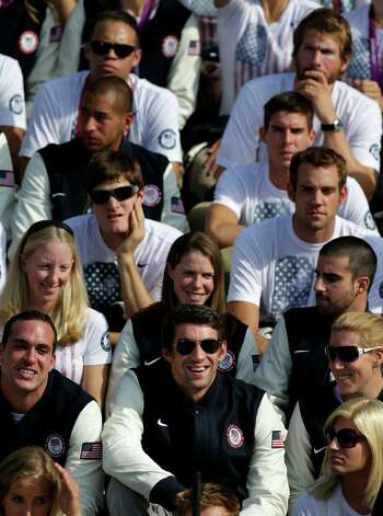 Olympic swimmer Michael Phelps, front row, center, smiles as he sits with fellow Olympians during a ceremony on the South Lawn of the White House in Washington, Friday, Sept. 14, 2012, where President Barack Obama welcomed the 2012 U.S. Olympic and Paralympic teams. Phelps ended his Olympic career in London with six medals and a record tally of 22 career medals. (AP Photo/Pablo Martinez Monsivais) Photo: Pablo Martinez Monsivais