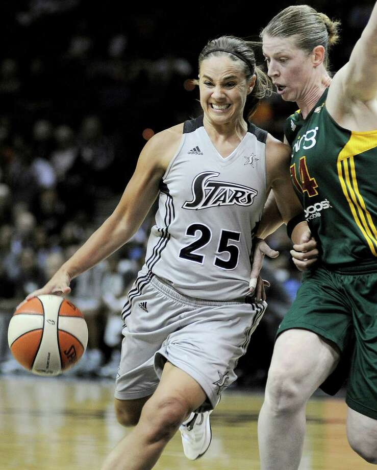 San Antonio Silver Stars' Becky Hammon (25) drives around Seattle Storm's Katie Smith during the first half of a WNBA basketball game, Friday Sept. 14, 2012, in San Antonio. Photo: Darren Abate, Express-News