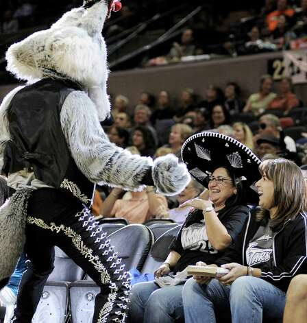 San Antonio Silver Stars mascot The Fox plays with fans during the first half of a WNBA basketball game against the Seattle Storm, Friday Sept. 14, 2012, in San Antonio. San Antonio won 90-66. Photo: Darren Abate, Express-News