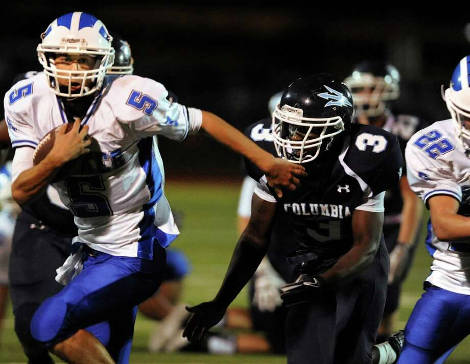 Shaker's quarterback Chris Landers (5), left, gets by Columbia's Kenny Mathieu (3) during their football game on Friday, Sept. 14, 2012, Columbia High in Columbia, N.Y. (Cindy Schultz / Times Union) Photo: Cindy Schultz / 00019195A