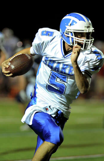 Shaker's quarterback Chris Landers (5) gains yards during their football game against Columbia on Fr