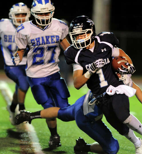 Columbia's Connor Kinzelman (1) gets past Shaker's Justin Safford (30) during their football game on